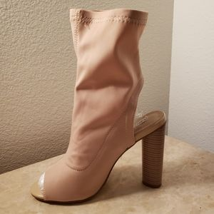 Nude open toe stretchy heels.